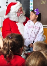 The kindergarten students gazed at Santa in wide-eyed wonder.